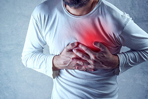 Man Experiencing Pain in His Chest