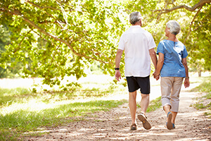 Older Couple Going on a Walk Through a Park