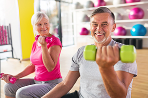 Older Couple Lifting Weights